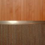 rivestimento parete in porfido e faggio